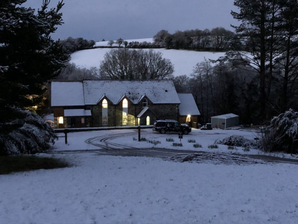 The Chapel Glowing in the Snow